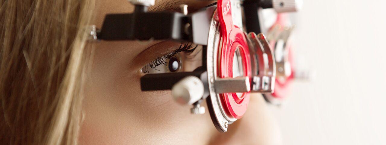 Eye doctor giving an eye exam to little boy in Akron,OH