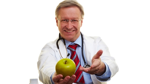 Doctor with apple
