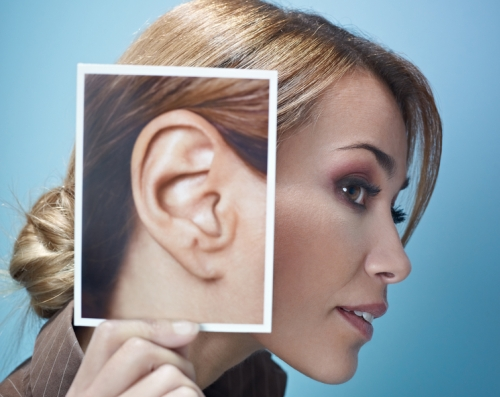 Woman with picture of ear