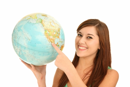 Girl pointing at globe