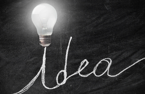 The word idea with a light bulb above it