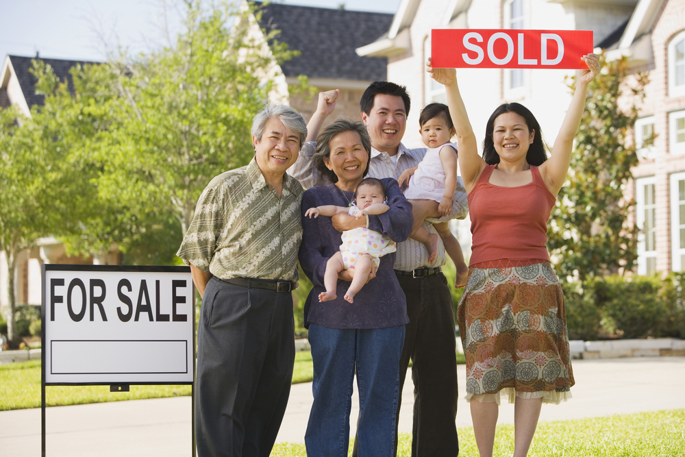 family in front of sold home
