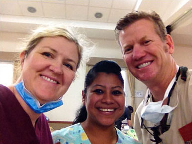 Photos of Dr. Tanner and his wife providing dental services in El Salvador