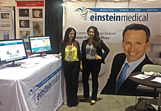 Two Einstein Medical salespeople at the 2014 Annual AAO Meeting