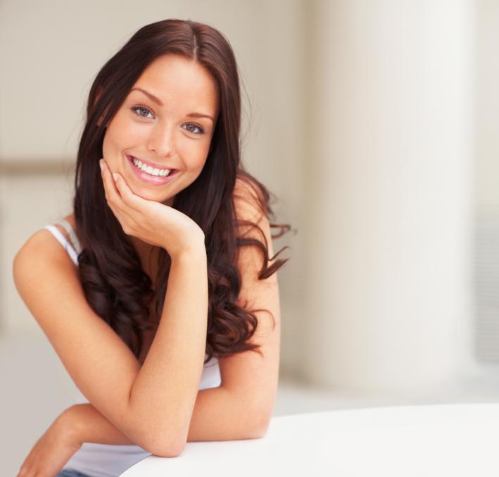 Brunette female shows off her new smile makeover