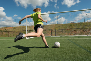 Soccer player about to kick in a goal