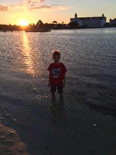 A boy in the waters of Seven Seas Lagoon