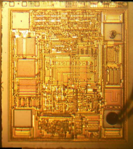 Die photos of the ICs on a EEVBLOG uCurrent
