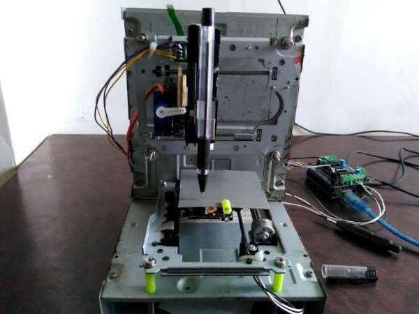 Mini CNC 2D plotter made from an old DVD drive and L293D motor shield