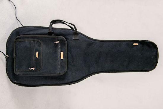 Play the guitar on a guitar bag