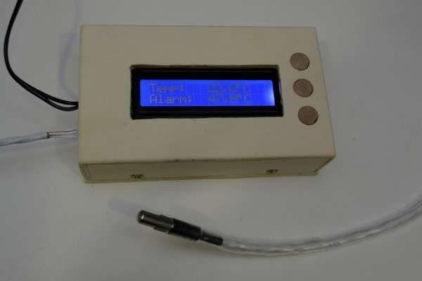 Temperature alarm for boiling milk