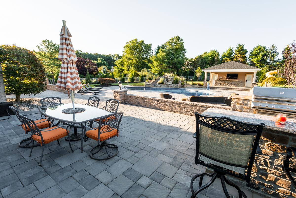 the right planting material to soften the hardscapes up against the home will result in an outdoor living space - Patio Materials