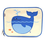 Front view of Beatrix NY Lucas the Whale Lunchbox. Embroidered design. Beige background with shades of blues and greys.