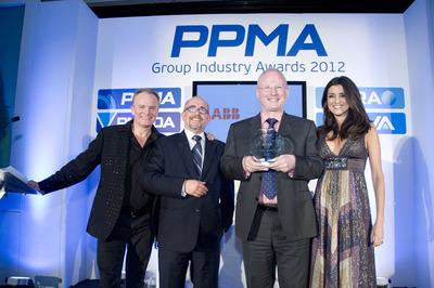 Matcon representatives receive an award.
