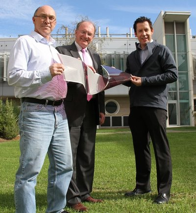 (L-R) Dr David Jones, Professor Andrew Holmes and Dr Scott Watkins holding a sheet of flexible solar cells..