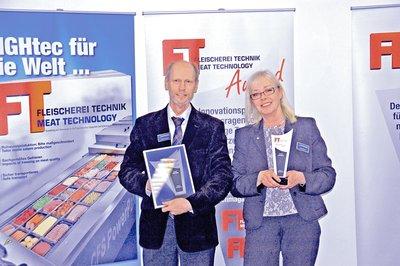 Jan van der Horst and Christel Boehmer accept the award.