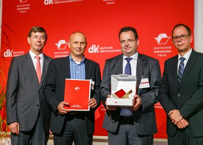 Axel Meier (2nd from right) and Olivier Peterges (2nd from left) accept the award.