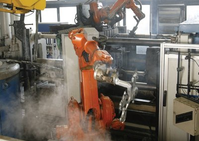 Figure 3: An example of robots work in coordination - and removing and deburring parts, then spraying the dies to prepare for the next drop - removing humans from a high temperature environment.