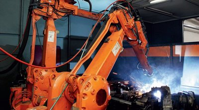 Figure 4: Two robots used to load, unload and weld parts with little human intervention and with a high degree of accuracy.