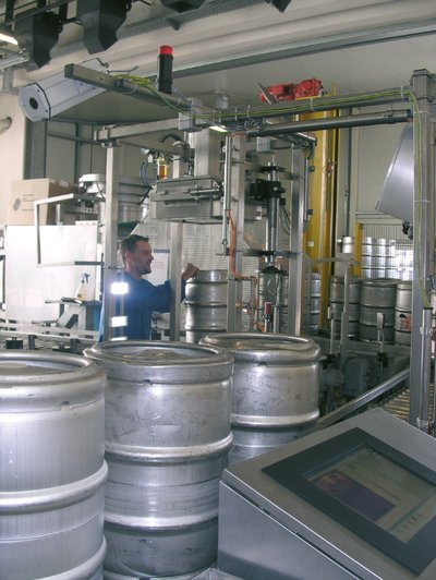 The infrared camera (top left of image) checks each passing keg.