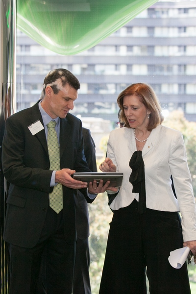 Professor Gardner presses the buttons to officially launch the centre. Image credit: RMIT University.