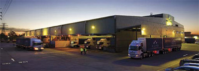 An evening view of trucks at a market warehouse