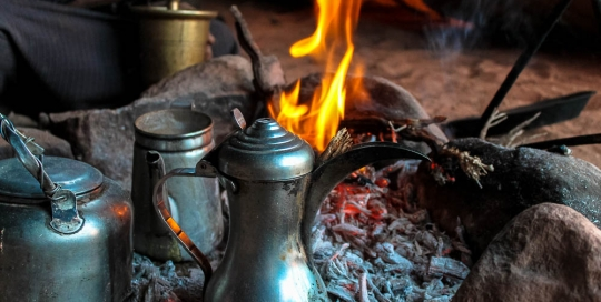 Bedouin coffee by the fire - Wadi Rum Tour