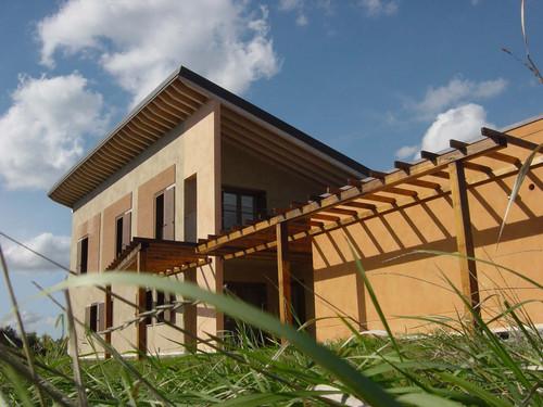 A4 architettura integrata casa monofamiliare for Portico laterale in stile casa in stile charleston