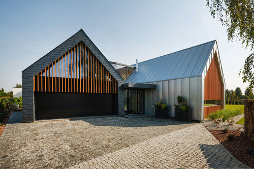 RS+ — Two barns house