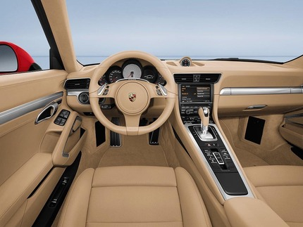 Porsche says the interior was inspired by the Carrera GT supercar. We see more Panamera than Carrera GT in there.