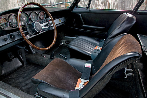 Stored in a barn for decades, the 911's interior is still in good condition. The driver's seat was replaced with an unrestored, vintage bucket seat that is similar to what the factory used in 356 race cars and Speedsters.