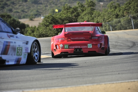 If it wasn't a Ferrari, it was a BMW nipping at the tail pipes of Flying Lizard's #45 GT3 RSR. Here the race-winning Porsche and the second-place M3 GT are entering the famous Corkscrew. Photo by Tom Loeser