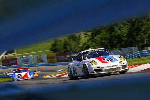 During practice for the Six Hours of The Glen, #59 climbed The Esses (Turn 2 grandstand, barely visible in background).