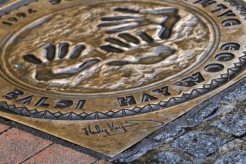 Former overall winners are immortalized on the walkways in the city's center. Featured here is the 1994 winning team (Dauer Porsche 962), which included driver Hurley Haywood.