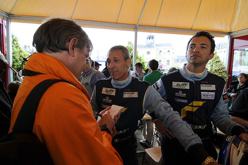 Current Porsche World Cup champion Gianluca Roda (left) is interviewed.