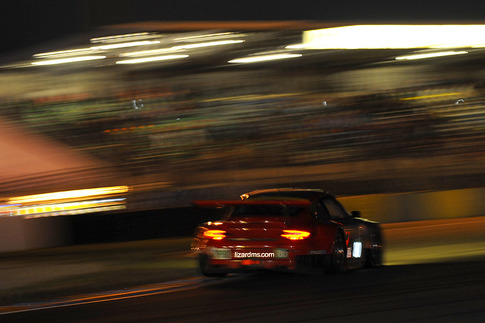 2012-spec Lizard RSR lifts a rear wheel in a night stint.