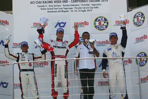 N. Technology driver Fabrizio Giovanardi (red driving suit) celebrates his first victory in the Panamera S&#39;s debut race. Photo courtesy N. Technology