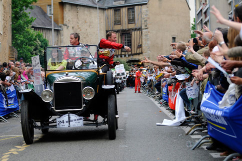 Seth Neiman (left) and Law participate in the 2009 drivers' parade at Le Mans in France. Photo by Bob Chapman