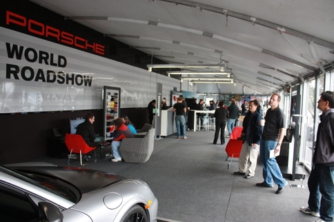 On display in the roadshow's tent were a GT2 RS, an interactive kiosk featuring a PCCB brake rotor and a regular cast iron unit, and some televisions playing Porsche commercials. Photo by Damon Lowney