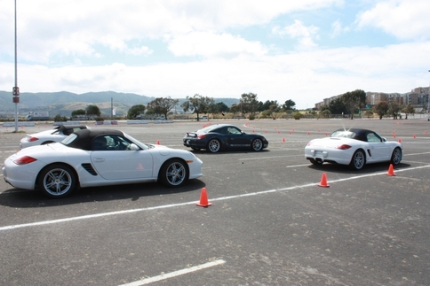 Mid-engined Porsches were driven on the autocross course. Foreground: Boxster (left) and Boxster S (right). Background: Boxster Spyder (left) and Cayman R (right). Photo by Damon Lowney