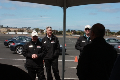 Porsche Sport Driving School instructors brief participants before they drive the 911s (and a couple Caymans). Former Porsche factory driver Kees Nierop (center) was there to help, as well. Photo by Damon Lowney