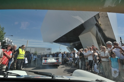 Here, at the beginning of the parade, we passed under the Porsche Museum. Photo by Randy Leffingwell