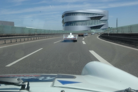 Heading towards the Mercedes-Benz Museum still on the Autobahn. We rounded a corner and came to a halt as thousands of spectators had crowded the road to take pictures. Photo by Randy Leffingwell