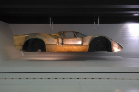 On display in the Porsche Museum in Stuttgart, this 908 body uses such thin fiberglass that light shines through it. Porsche design and engineering strive for the lightest weight possible in its road and race cars. Photo by Randy Leffingwell