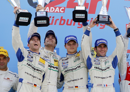 Race winners from left to right: Timo Bernhard, Romain Dumas, Marc Lieb, Lucas Luhr. Photo courtesy Porsche