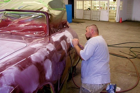 Ryan Moreland buffs the first coat of a repainted #5142. 