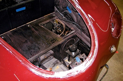 Blue tape marks problem areas in front trunk, like chips, poor paint, and incorrect colors.