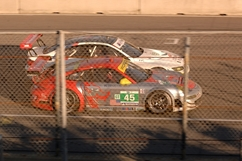 Patrick Long in the #45 GT3 RSR drag races Bill Auberlen in the #55 BMW coming off the famous hairpin Turn 11. An hour later both BMW and Porsche finished on the same lap, though #45 took the class victory. Photo by Randy Leffingwell