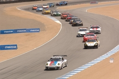 In a 16-car field, it's nice to be number one. The horde of 15 cars chased race leader Andrew Davis for the first 26 laps till the first round of pit stops mixed things up. Photo by Randy Leffingwell