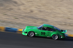 Johannes van Overbeek drives his father's 911 spec racer in a Porsche Racing Club race at Infineon. Photo by Damon Lowney